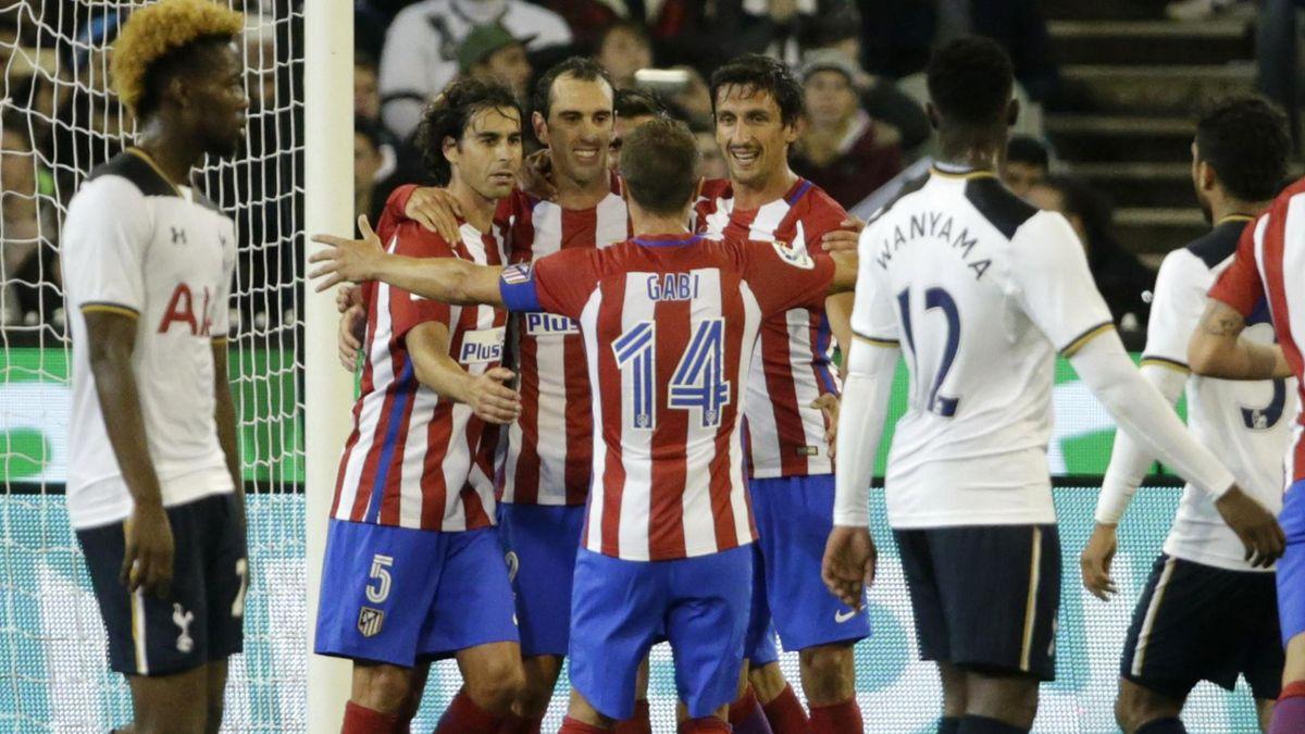 Atletico Madrid's Diego Godin celebrates scoring their first goal with team-mates.