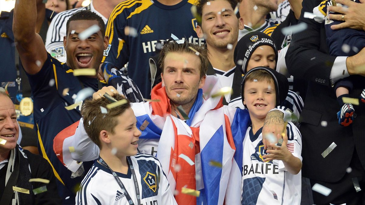 David Beckham #23 of Los Angeles Galaxy celebrates with his sons Brooklyn Beckham, Romeo Beckham and Cruz Beckham after the Galaxy defeat the Houston Dynamo 3-1 to win the 2012 MLS Cup at The Home Depot Center on December 1, 2012 in Carson, California.