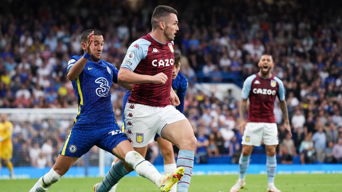 Aston Villa's John McGinn under pressure from Chelsea's Hakim Ziyech during the Premier League match between Chelsea and Aston Villa at Stamford Bridge on September 11