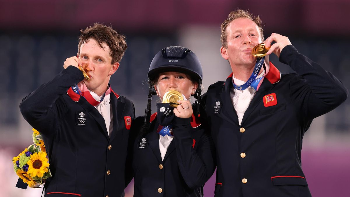 Gold medalists Tom McEwen, Laura Collett and Oliver Townend of Team Great Britain pose with their gold medals during the Eventing Jumping Team