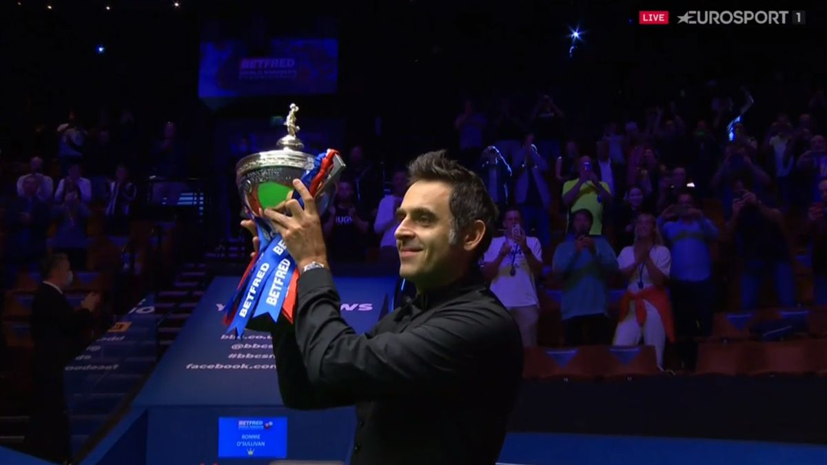 Ronnie O'Sullivan lifts the trophy after winning the 2020 World Snooker Championship