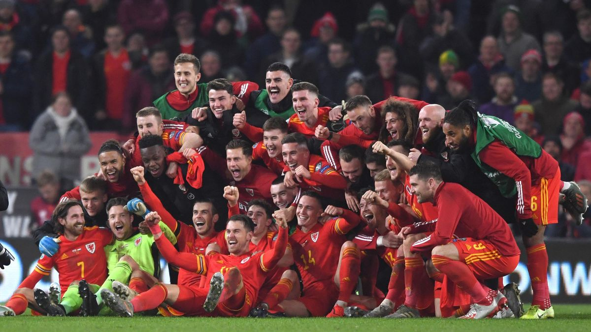 Wales player Aaron Ramsey (front) joins in the celebrations with Gareth Bale and his team mates after the UEFA Euro 2020 qualifier between Wales and Hungary at Cardiff City Stadium on November 19, 2019 in Cardiff, Wales.