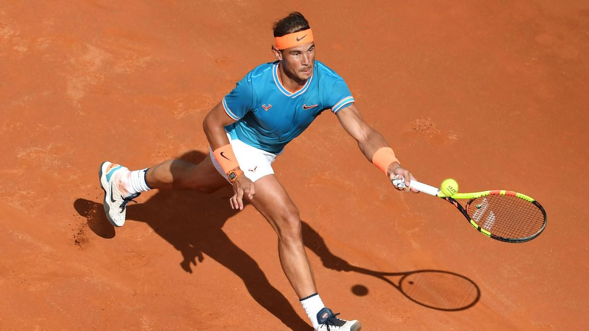 Rafael Nadal of Spain returns to Novak Djokovic of Serbia during their ATP Masters tournament final tennis match at the Foro Italico in Rome on May 19, 2019.