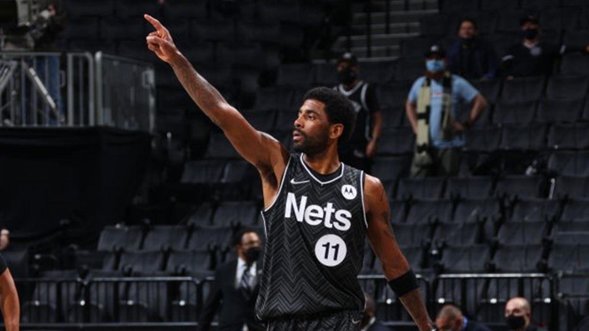 Kyrie Irving #11 of the Brooklyn Nets looks on during the game against the Boston Celtics on March 11, 2021 at Barclays Center in Brooklyn
