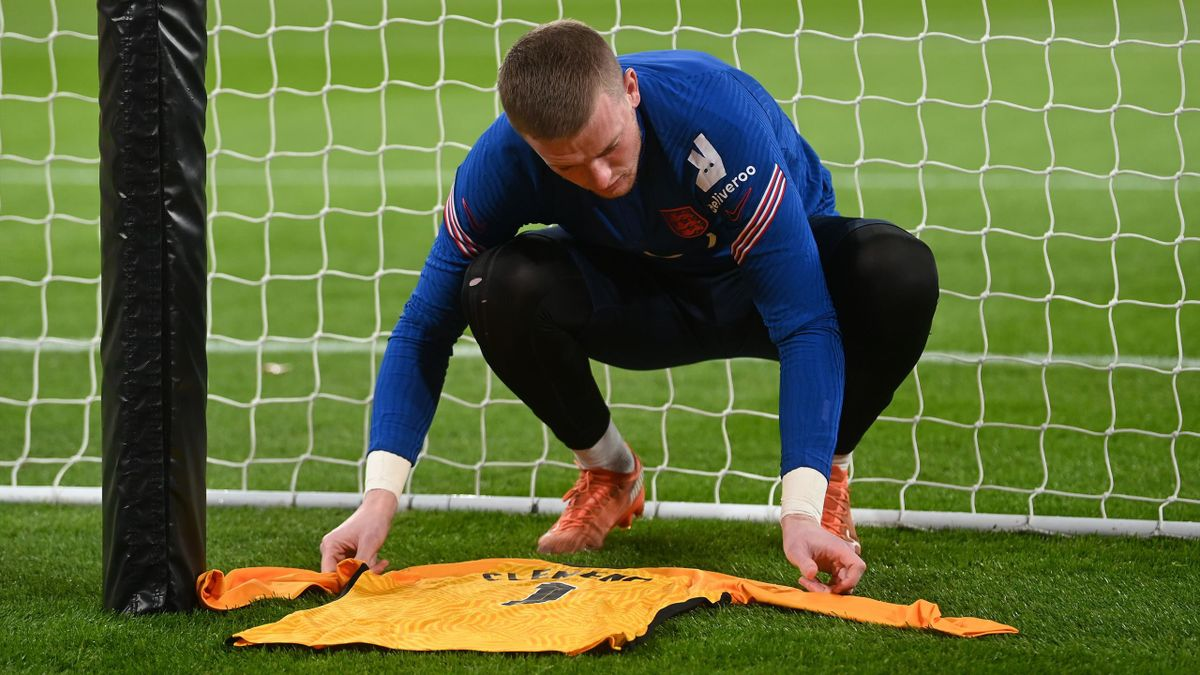 Jordan Pickford lays a Ray Clemence shirt behind the goal before England's game against Iceland