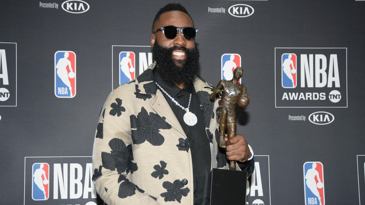 Houston Rockets guard James Harden poses for photos with his MVP award during the NBA Award Show at Barker Hanger.