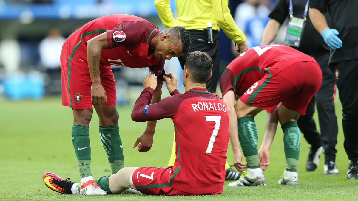 Cristiano Ronaldo gives his captain's armband to Nani during the Euro 2016 final football match between Portugal and France – PUB NOT IN UK
