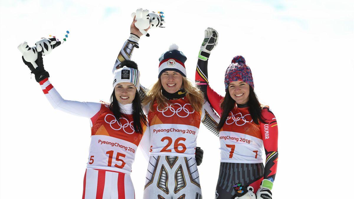 old medallist Ester Ledecka (C) of the Czech Republic celebrates with silver medallist Anna Veith (L) of Austria and bronze medallist Tina Weirather of Liechtenstein