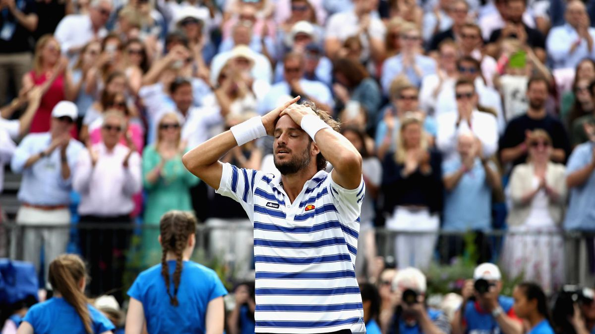 Feliciano Lopez of Spain celebrates victory in the mens singles final against Marin Cilic of Croatia