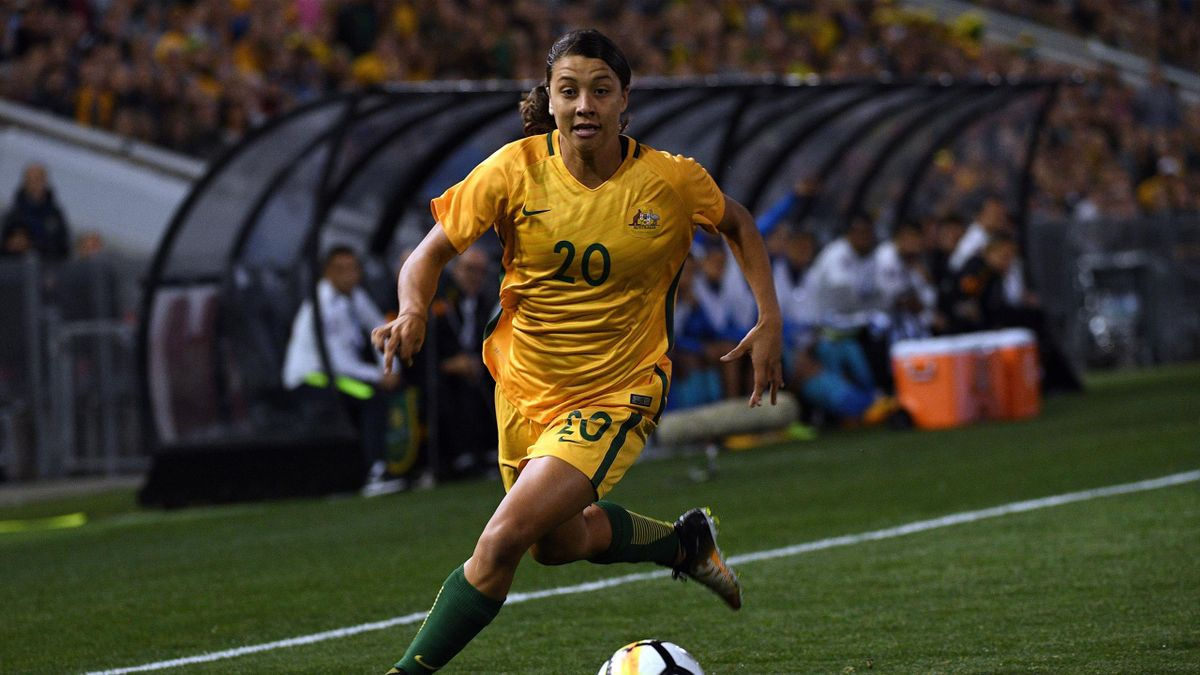 Australia's Sam Kerr runs with the ball during their women's friendly football match against Brazil at Newcastle on September 19, 2017.