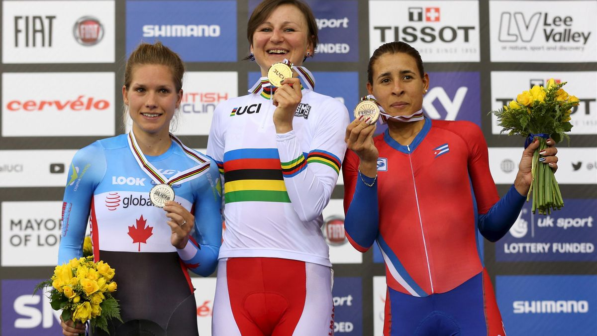 Winner Katarzyna Pawlowska of Poland (C), second placed Jasmin Glaesser of Canada (L) and third placed Arlenis Sierra Canadilla of Cuba (R) pose on the podium of the women's points race final.