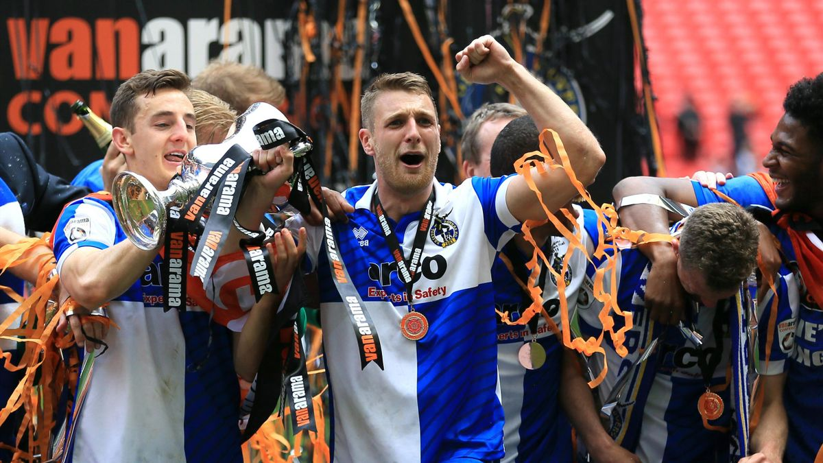 Bristol Rovers' Lee Brown celebrates with the play-off trophy
