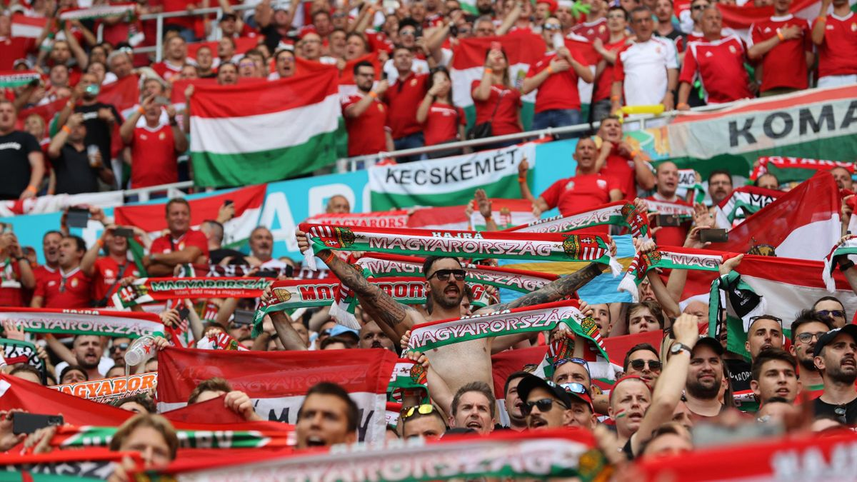 Hungary's fans celebrate after the UEFA EURO 2020 Group F football match between Hungary and France at Puskas Arena in Budapest on June 19, 2021.