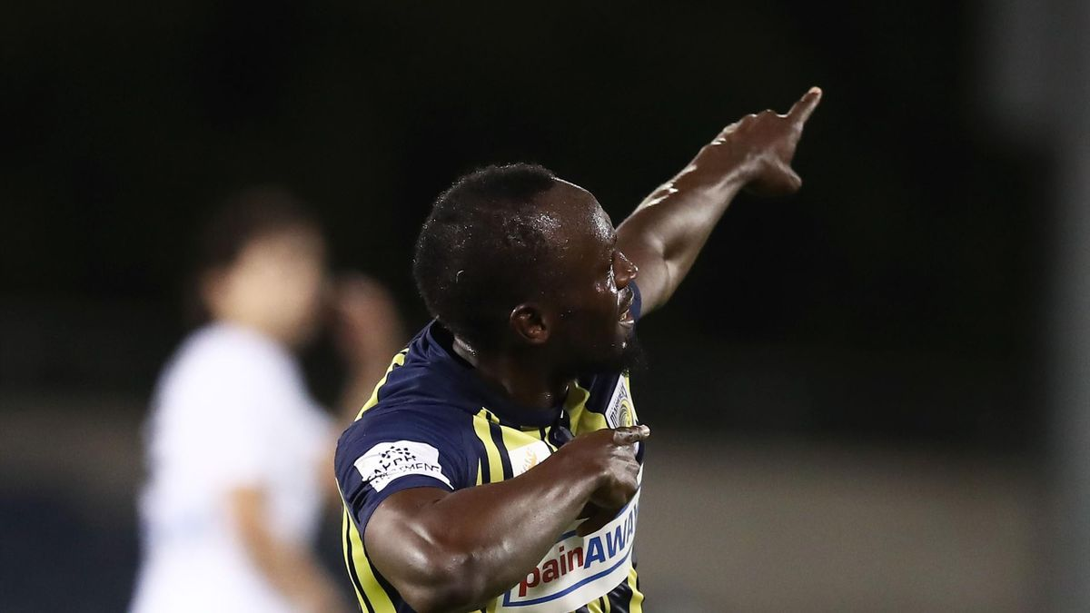 Olympic sprinter Usain Bolt (R) celebrates scoring a goal for A-League football club Central Coast Mariners in his first competitive start for the club against Macarthur South West United in Sydney on October 12, 2018.
