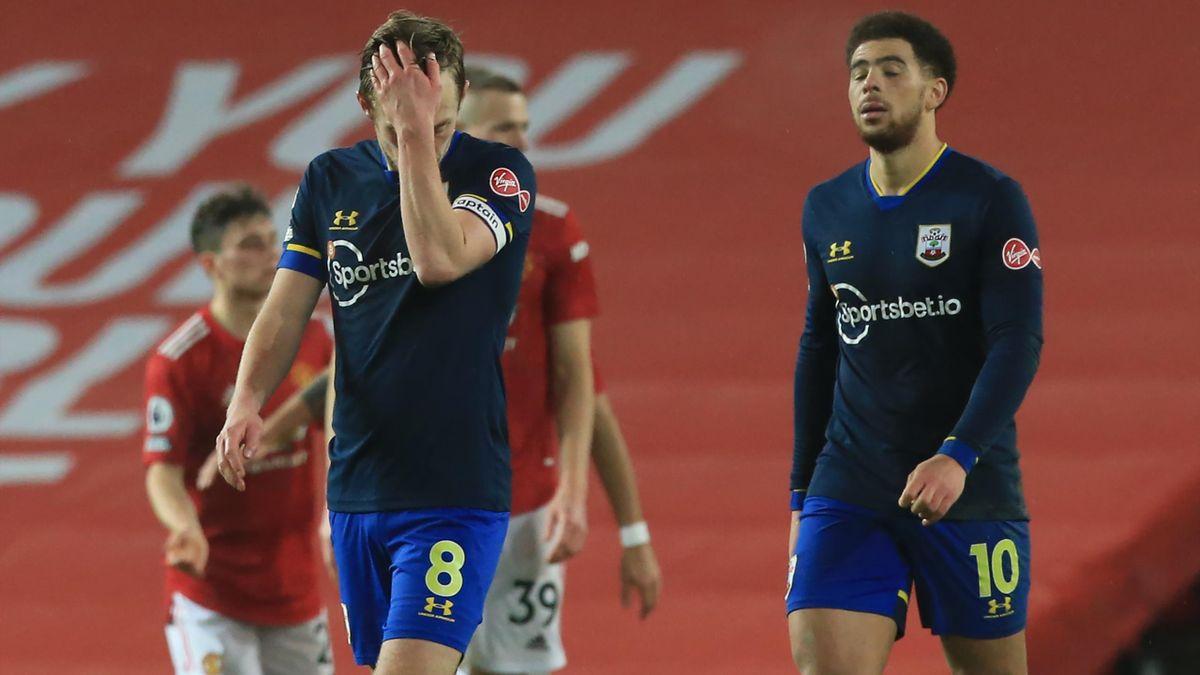 Southampton's English midfielder James Ward-Prowse (L) reacts