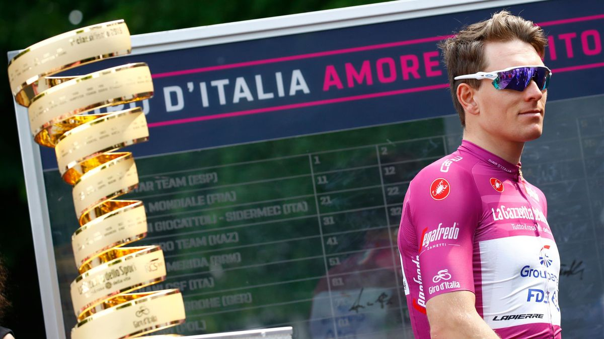 Team Groupama-FDJ rider France's Arnaud Demare, wearing the Cyclamen jersey of King of the General Point Classification, walks past the Giro Trophy before the start of stage twelve of the 102nd Giro d'Italia - Tour of Italy - cycle race, 158kms from Cuneo