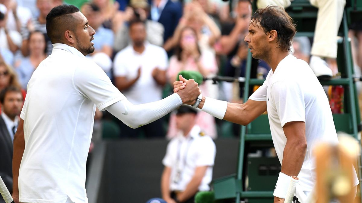 Rafael Nadal of Spain shakes hands at the net with Nick Kyrgios of Australia after their Men's Singles second round match during Day four of The Championships - Wimbledon 2019 at All England Lawn Tennis and Croquet Club on July 04, 2019 in London, England
