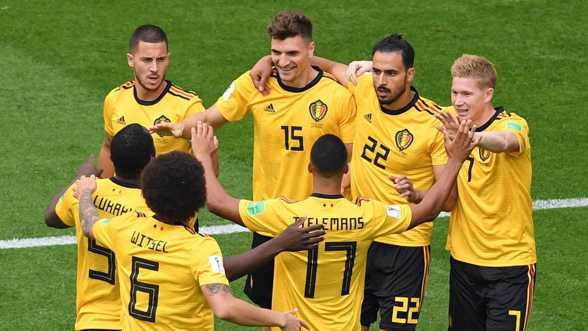Belgium's defender Thomas Meunier (C, #15) is congratulated by teammates