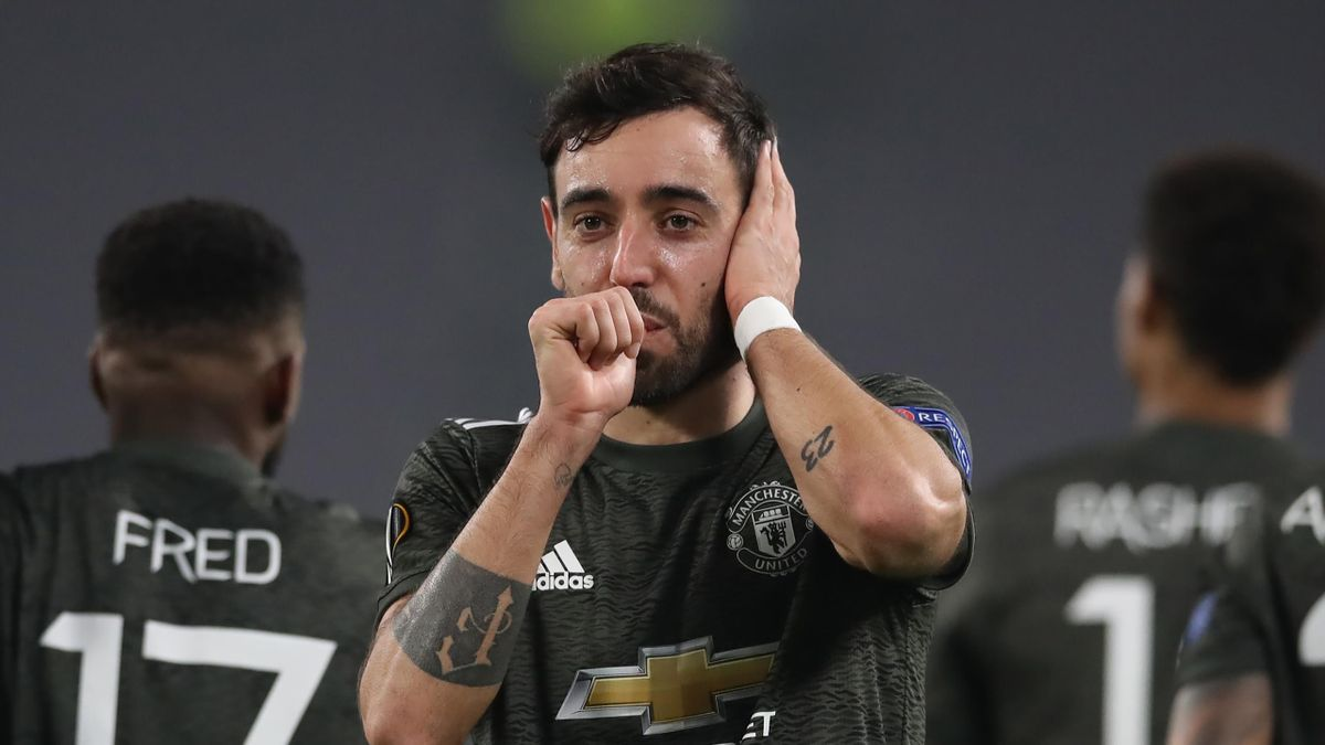 Bruno Fernandes of Manchester United celebrates after scoring to give the side a 2-0 lead during the UEFA Europa League Round of 32 match between Real Sociedad and Manchester United at Allianz Stadium