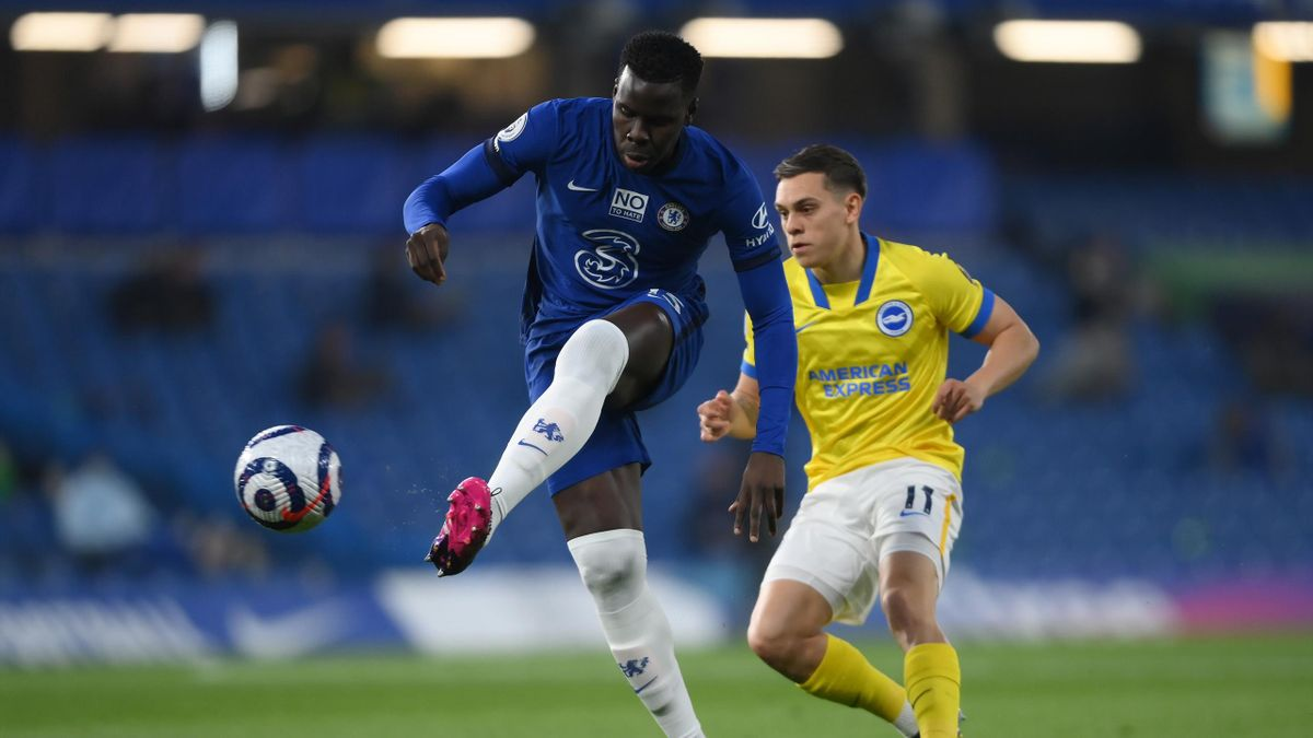Kurt Zouma of Chelsea is put under pressure by Leandro Trossard of Brighton & Hove Albion during the Premier League match between Chelsea and Brighton & Hove Albion at Stamford Bridge on April 20, 2021 in London, England.