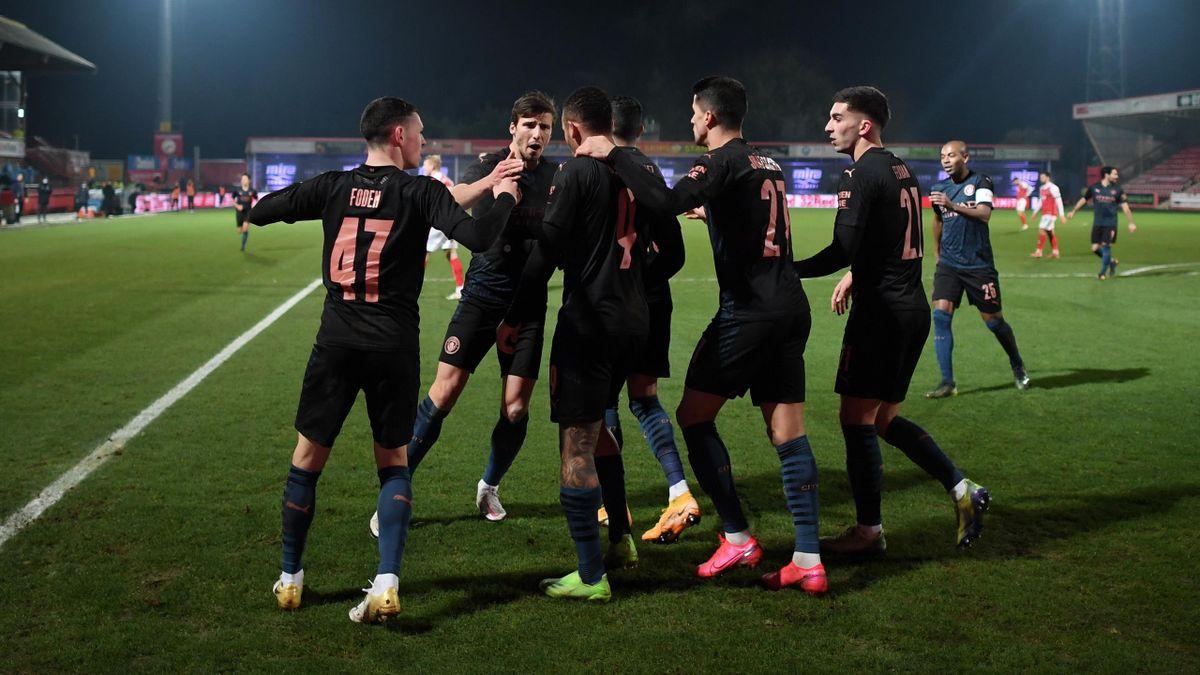 Gabriel Jesus of Manchester City celebrates with teammates