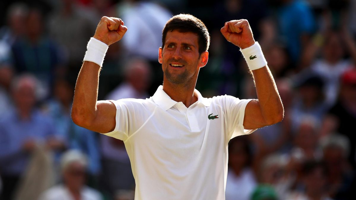 Novak Djokovic of Serbia celebrates victory after the Gentlemen's Singles third round match against Ernests Gulbis of Latvia at Wimbledo