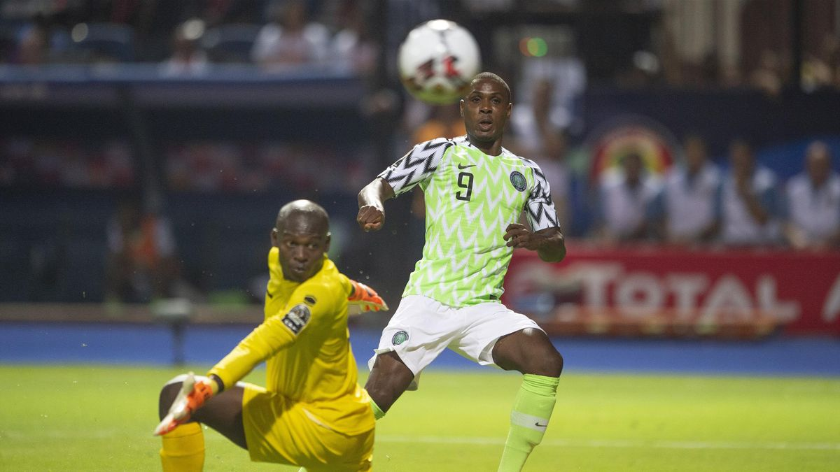 Odion Ighalo of Nigeria curls the ball past JONATHAN NAHIMANA of Burundi to score the winning goal during the 2019 Africa Cup of Nations Group B match between Nigeria and Burundi at Alexandria Stadium on June 22, 2019 in Alexandria, Egypt.