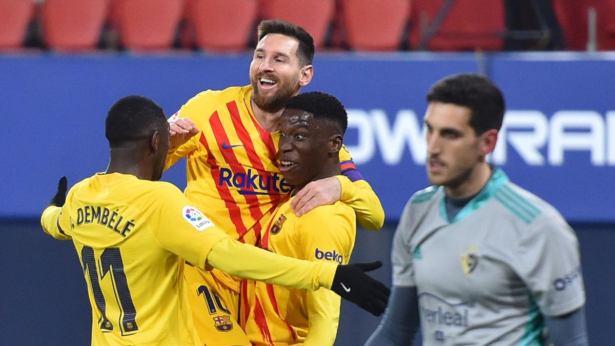 Ilaix Moriba of FC Barcelona celebrates with Lionel Messi and Ousmane Dembele after scoring their team's second goal during the La Liga Santander match between C.A. Osasuna and FC Barcelona at Estadio El Sadar on March 06, 2021 in Pamplona, Spain