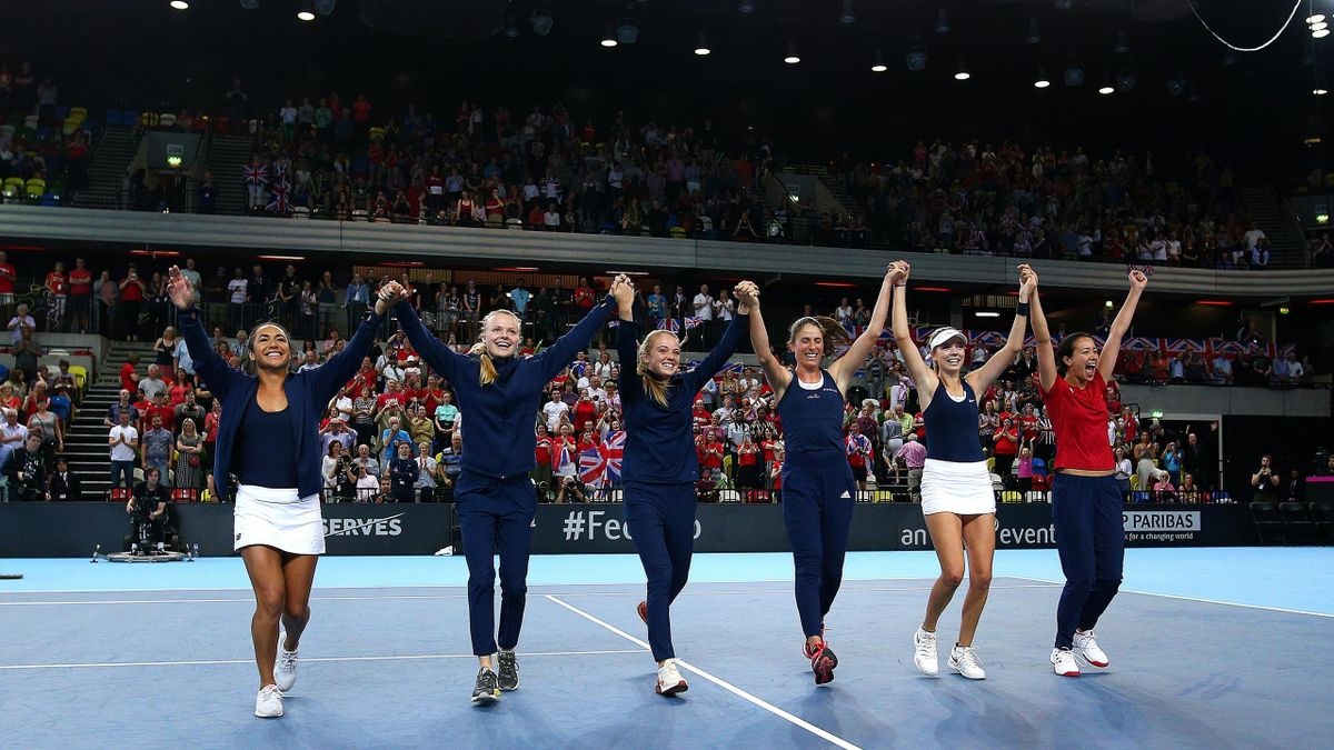 Heather Watson, Harriet Dart, Katie Swan, Johanna Konta, Katie Boulter and Captain Anne Keothavong celebrates the teams win and qualification during the Fed Cup World Group II Play-Off match between Great Britain and Kazakhstan at Copper Box Arena on Apri