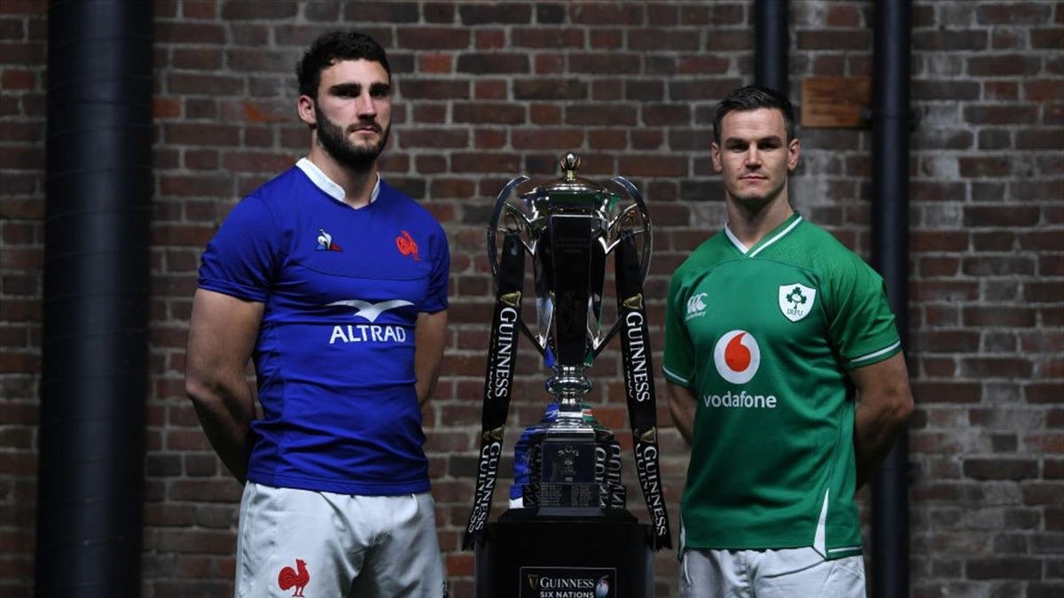 Captains Charles Ollivon of France and Jonathan Sexton of Ireland pose with the Six Nations Trophy during the Guinness Six Nations Launch at Tobacco Dock on January 22, 2020 in London, England