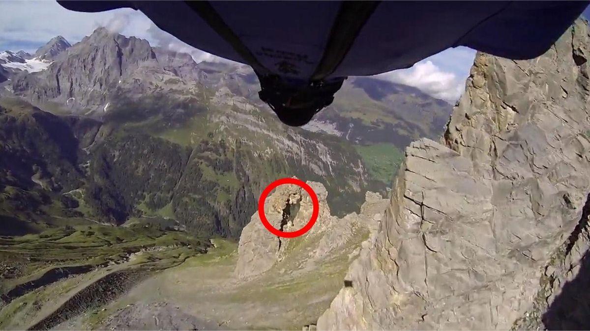 Wingsuit man flies through tiny gap in mountain at 130mph