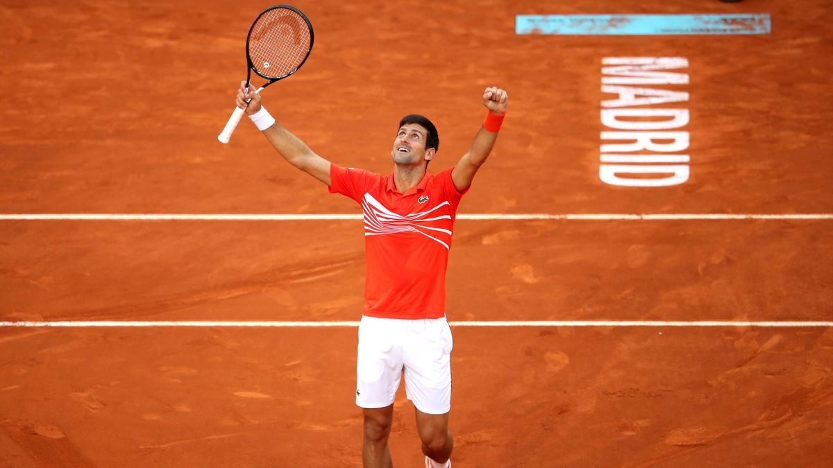 Novak Djokovic of Serbia celebrates victory in his men's singles final against Stefano Tsitsipas of Greece during day nine of the Mutua Madrid Open at La Caja Magica on May 12, 2019 in Madrid, Spain.