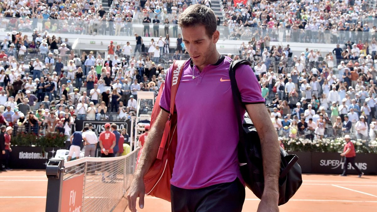Juan Martin Del Potro of Argentina leaves after being defeated by Novak Djokovic of Serbia during the quarter-finanl match at the ATP Tennis Open tournament at the Foro Italico on May 20, 2017 in Rome. Serbia's Novak Djokovic, the second seed, cruised int