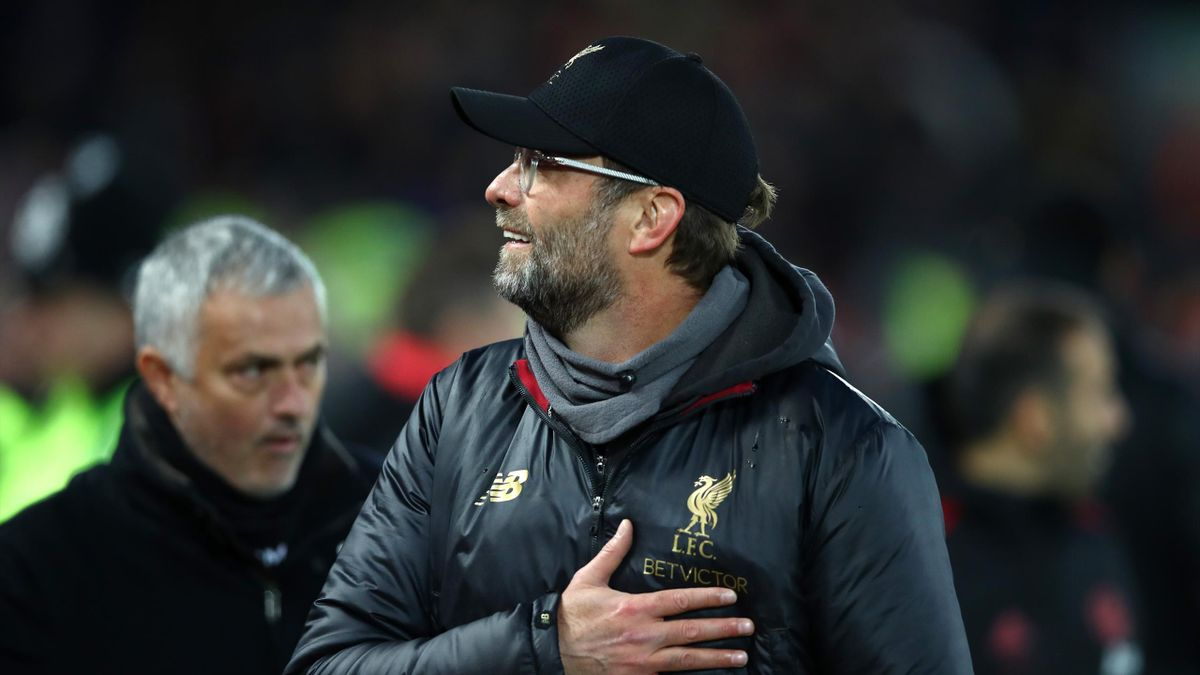 Jurgen Klopp, Manager of Liverpool and Jose Mourinho, Manager of Manchester United looks on prior to the Premier League match between Liverpool FC and Manchester United at Anfield on December 16, 2018 in Liverpool, United Kingdom