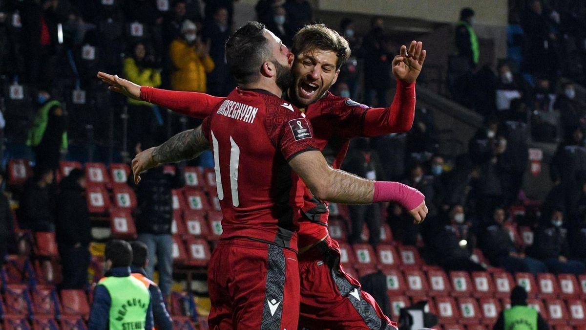 Armenia celebrate scoring against Romania