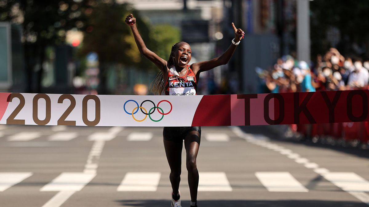 Peres Jepchirchir of Team Kenya celebrates as she crosses the finish line to win the gold medal in the Women's Marathon Final on day fifteen of the Tokyo 2020 Olympic Games