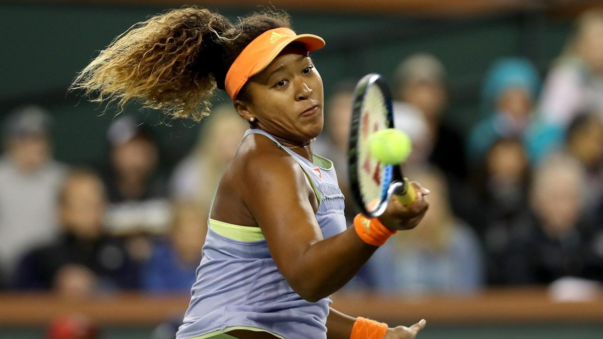 Naomi Osaka of Japan returns a sho to Simona Halep of Romania during semifinals of the BNP Paribas Open at the Indian Wells Tennis Garden on March 16, 2018 in Indian Wells, California.