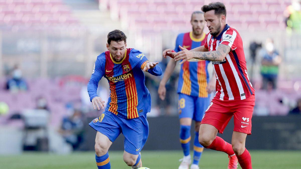 Lionel Messi (l.) und Saúl Ñíguez (r.)