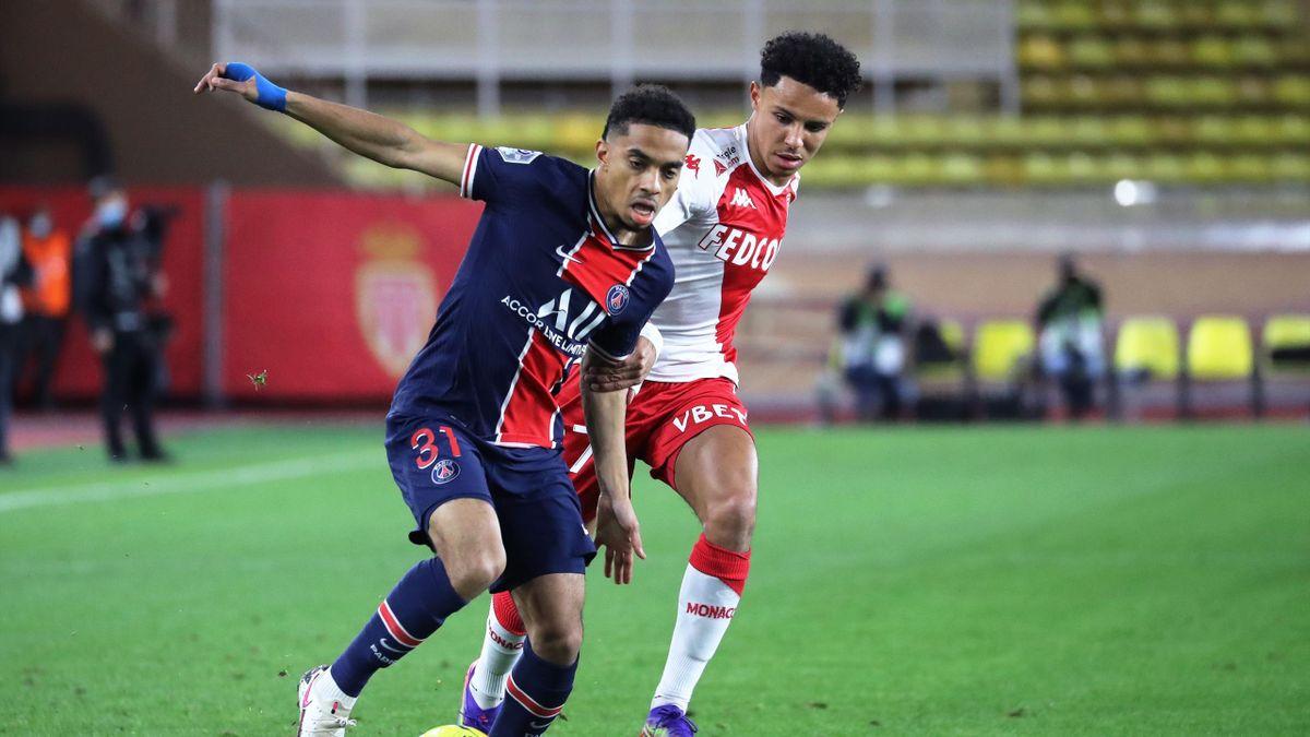 Paris Saint-Germain's French defender Colin Dagba (L)