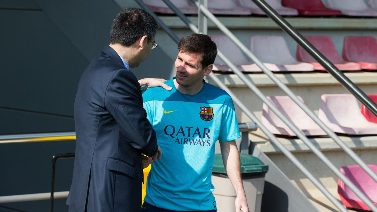 President of FC Barcelona Josep Maria Bartomeu (L) greets Lionel Messi during the training session at Ciutat Esportiva on April 14, 2014 in Barcelona, Spain