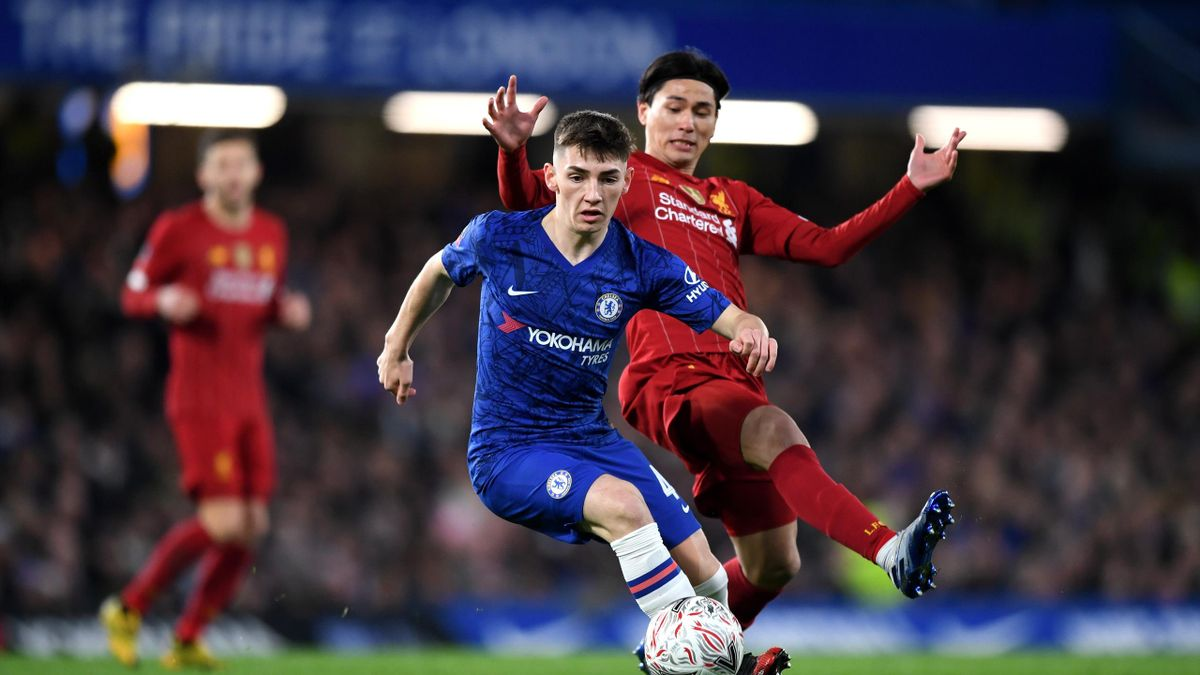 Billy Gilmour of Chelsea is closed down by Takumi Minamino of Liverpool during the FA Cup Fifth Round match between Chelsea FC and Liverpool FC at Stamford Bridge on March 03, 2020 in London, England.