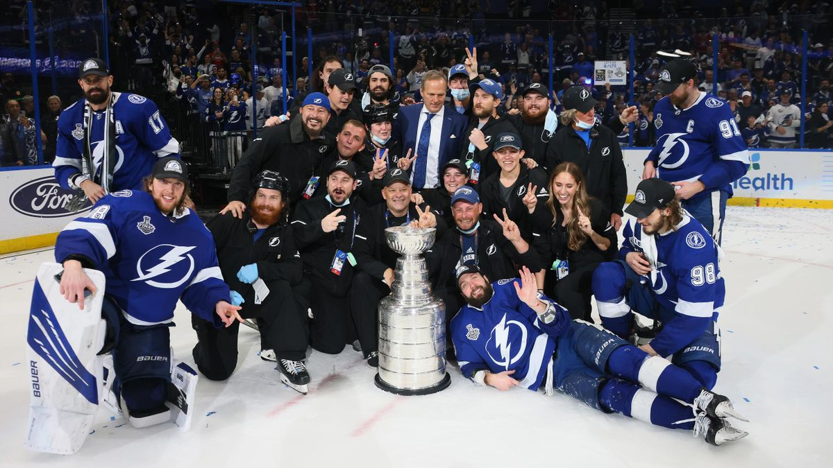 The Tampa Bay Lightning celebrate after defeating the Montreal Canadiens 1-0 in Game Five to win the 2021 NHL Stanley Cup Final at Amalie Arena on July 07, 2021 in Tampa, Florida
