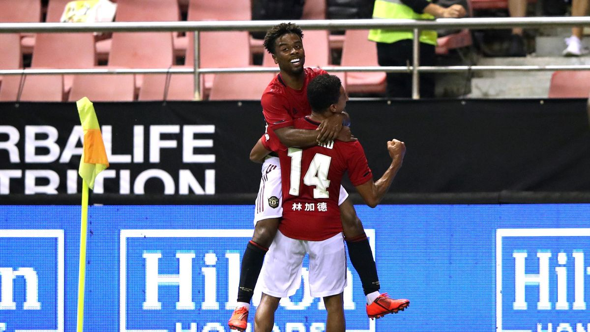 Angel Gomes (L) of Manchester United celebrates scoring his side's second goal with his team mate Jesse Lingard (R) during the International Champions Cup match between Tottenham Hotspur and Manchester United at the Shanghai Hongkou Stadium on July 25, 20