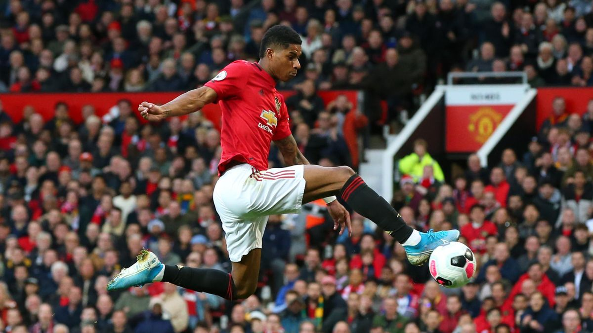 Marcus Rashford of Manchester United scores his sides first goal during the Premier League match against Liverpool at Old Trafford on October 20, 2019.