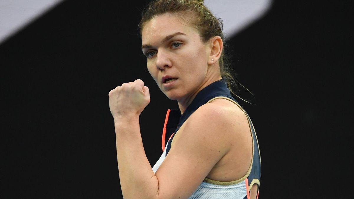 Romania's Simona Halep reacts as she plays against Australia's Lizette Cabrera