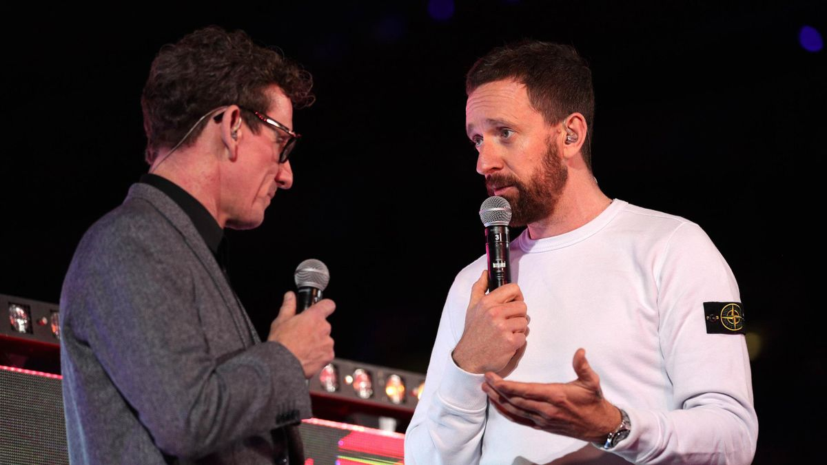Sir Bradley Wiggins (R) speaks on stage, as he introduces Day 5, ahead of the London Six Day Race