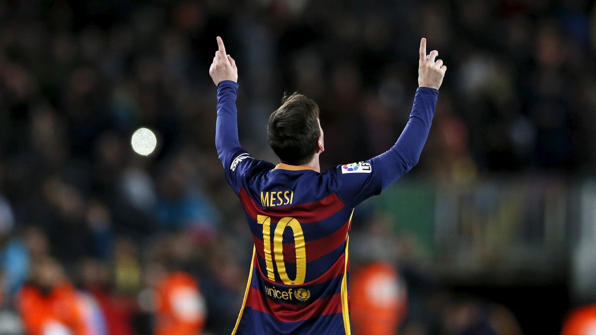 Lionel Messi points towards... the spaceship that delivered him to Planet Earth? the benevolent creator who made sent him to entertain billions across the world? Take your pick of explanations...