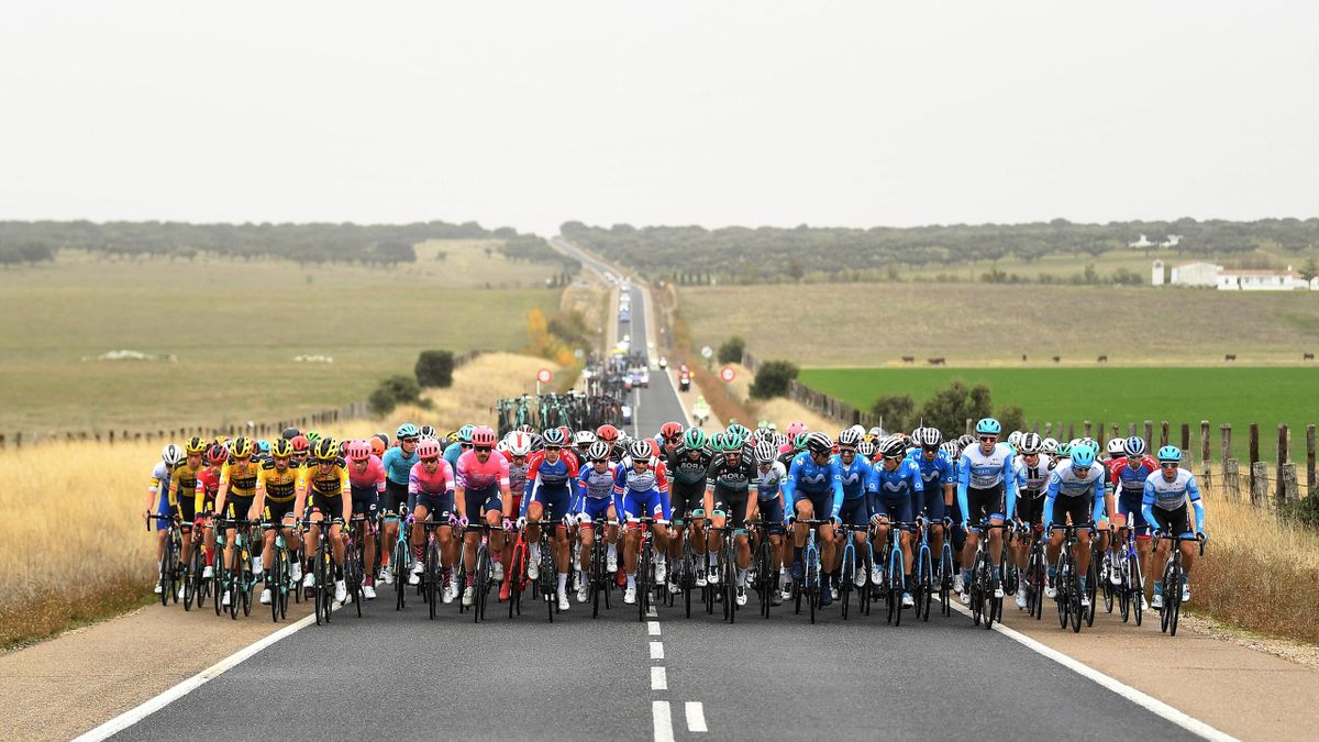 The peloton rides along during the opening hour of stage 16 of La Vuelta 2020