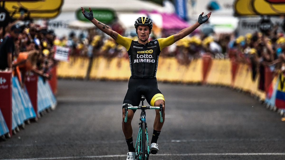Slovenia's Primoz Roglic celebrates as he crosses the finish line to win the 19th stage of the 105th edition of the Tour de France cycling race, on July 27, 2018 between Lourdes and Laruns, southwestern France.