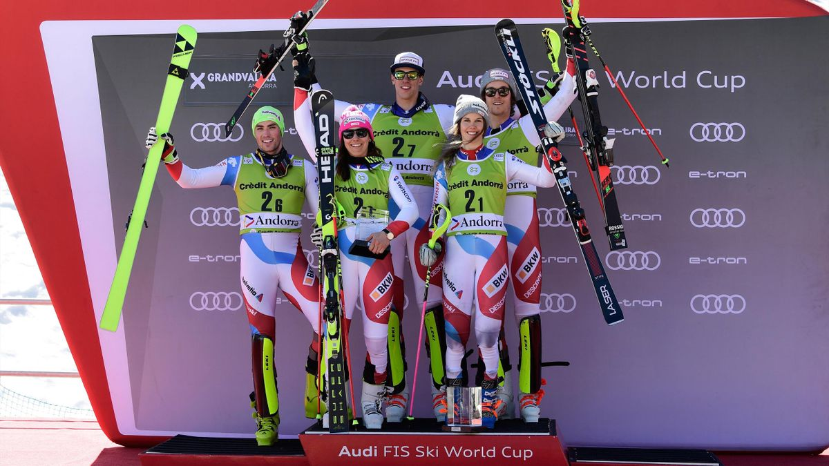 Daniel Yule, Wendy Holdener, Ramon Zenhaeusern, Aline Danioth and Sandro Simonet celebrate with the trophy during the podium ceremony after winning in the Alpine team event.